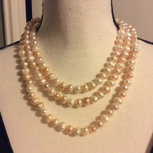 "Freshwater Pearl Necklace. 48"" long."